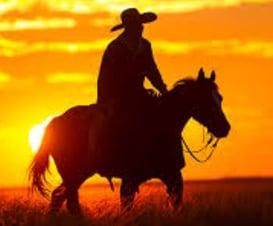 Riding at sunset WesternHorseman