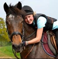 girl hugging horse RegentInsuranceGroup